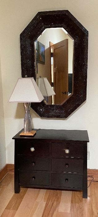 Glass tiled  octagonal mirror abd Craftsman styled chedt of drawers
