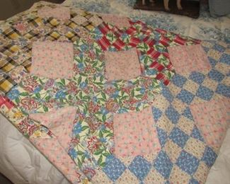 Hand quilted quilt made with feed sack material