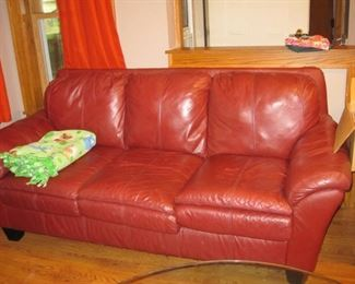$150.00, Red Leather sofa vg condition