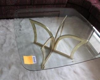 Contemporary glass topped cocktail/ coffee table with brass metal base