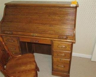 Golden oak roll top desk with tambour desktop front