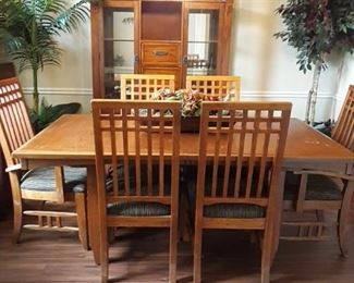 Nice dinning table 6 chairs , table has a leaf,  and china cabinet