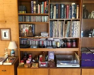Teal entertainment center; LPs, CDs and books.