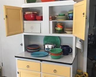 Restored Hoosier cabinet.  Vintage Fiesta pieces.