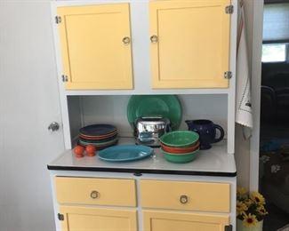 Restored Hoosier cabinet. Vintage Fiesta dinnerware.