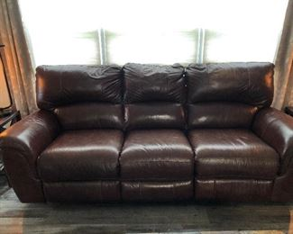 Power reclining sofa. Maroon in color.  Matching oversized recliner to match.