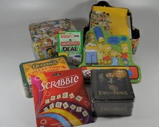 2 Simpson's Tria Game sets, a Scrabble refrigerator magnet game, a Monopoly gards game, Lord of the Rings Action Flipz cards, and Crayola Collectors Colors (72): $30