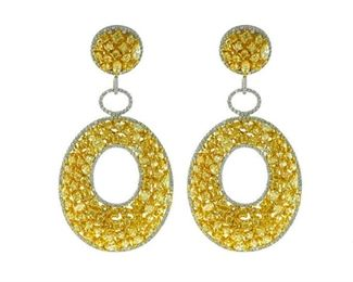 A PAIR OF YELLOW AND WHITE DIAMOND EARRINGS. 18KT white and yellow gold. Features 20.12 carats of fancy yellow white diamonds.