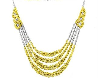 A WHITE AND YELLOW DIAMOND NECKLACE, 49.73 CARATS