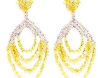 A PAIR OF YELLOW AND WHITE DIAMOND EARRINGS Elegant natural fancy yellow and white diamond chandelier earrings, 16.73 carats of beautiful vibrant yellow and white diamonds, set in white 18K gold.