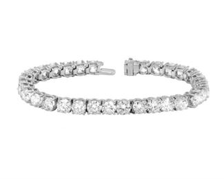 A DIAMOND TENNIS BRACELET, 20.35 CARATS A timeless classic, a four-prong diamond-mounted tennis bracelet, all set in 18KT white gold. A stunning collection of 33 round diamonds totaling 20.35 carats in weight.