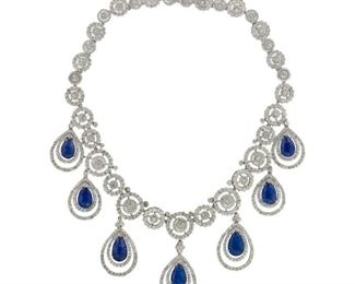 A TANZANITE AND DIAMOND DROP NECKLACE A stunning Tanzanite and Diamond Drop Necklace. This very special piece is set with seven pear-shaped tanzanite drops, the entire piece further emblazoned with 35.45 carats of white diamonds. A total of 54.10 carats of beautiful tanazanite grace this original creation.