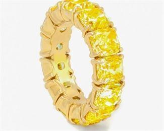 YELLOW DIAMOND ETERNITY BAND, 10.85 CARATS Timeless natural yellow diamond Eternity band, features 13 cushion cut diamonds totaling 10.85 carats, all set in 18K yellow gold.