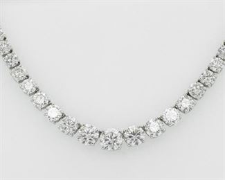 A MAGNIFICENT DIAMOND RIVIERA NECKLACE, 31 CARATS Magnificent classic Riviera diamond necklace featuring 31 carats of diamonds, 85 round diamonds with two central EGL certified round diamonds on each side, 1.33 carats (D, SI2) and 1.25 carats (D, SI1) respectively, all set in platinum. With two E.G.L. certificates