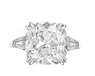 A 5.52 CARAT WHITE DIAMOND RING A gorgeous diamond and platinum ring featuring a GIA certified 5.52 white diamond at center F, SI2 (RADC816) in a platinum setting with tapered baguette cut diamonds totaling .75 carats mounted to either side. With GIA certificate.