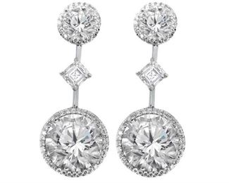 AN IMPRESSIVE PAIR OF DIAMOND EARRINGS Most impressive and important pair of diamond earrings with four GIA certified diamonds. This spectacular presentation features two round diamonds 12.36 carats total (I-VS-2), suspended from two additional round diamonds (J-VS1,2 RDC3342, RDC3511), the four principal stones further accented by 3.25 carats of side diamonds, including two Ascher cut diamonds weighing 1.21 carats total. The four principal diamonds all GIA certified.