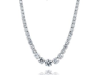 A FINE DIAMOND NECKLACE, 95 CARATS A fantastic diamond Riviera necklace set with 95 carats of round cut graduated-size diamonds - one of the finest such necklaces obtainable. Prong set in platinum, the gorgeous stones include the stunning 9.25 carat round center stone graduating to two stones totaling 12.38 carats; a 5.03 carat stone; a 4.14 carat stone; a 3.00 carat stone; a 2.95 carat stone; a 2.74 carat stone; 2.62 carat stone, two stones weighing 4.90 carats together; four stones weighing 8.23 carats together, four stones weighing 6.26 carats combined; four stones weighing 5.11 carats together; a 1.32 carat stone; a 1.02 carat stone; a .94 carat stone, two stones weighing 2.36 carats combined; four stones weighing 4.17 carats together; six stones weighing 5.42 carats total, and 31 stones weighing 19.15 carats all in.