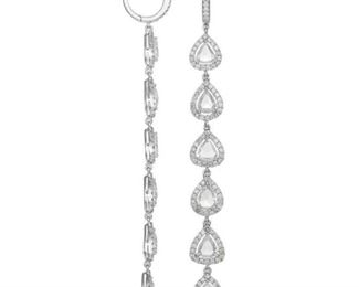 A PAIR OF WHITE DIAMOND EARRINGS Sophisticated white pendant diamond earrings adorned with 5.40 carats of white diamonds mounted in 18K gold.