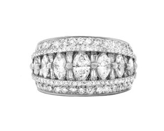 A LADY'S DIAMOND BAND Wide platinum diamond band mounted with 4.25 carats of marquise, baguette, and round cut diamonds half way about the band.