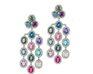 A PAIR OF SAPPHIRE AND DIAMOND EARRINGS Over the rainbow chandelier earrings, a combination of multi-colored sapphires and diamonds set in 18KT white gold. Features 63.2 carats of multi-colored sapphires and 9.20 carats of white diamonds.