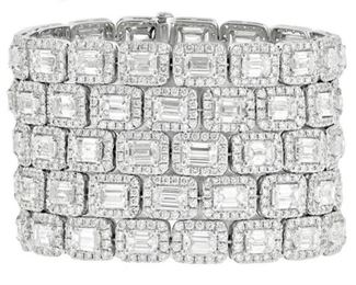 A DIAMOND CUFF BRACELET, 74.00 CARATS Extravagant 18KT white gold cuff bracelet with five rows of emerald cut diamonds, each in turn fully surrounded by a halo of round diamonds. 74.00 carats of diamonds.