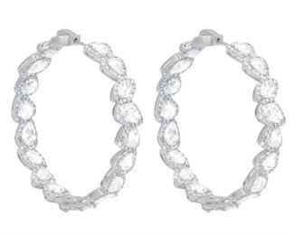 DIAMOND HOOP EARRINGS, 12.62 CARATS Pair of distinctive diamond hoop earrings, 18KT gold with 36 rose cut diamonds almost entirely encircling the hoops. A total of 12.62 carats of diamonds in all.