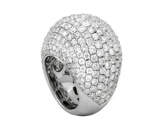 A DIAMOND FASHION RING Special white gold and pave diamond fashion ring, 18K gold studded throughout with 11.52 carats of white diamonds.