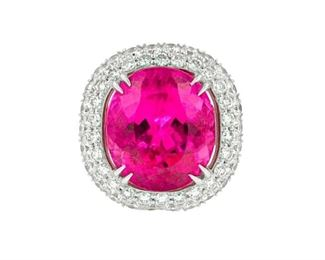 A PINK TOURMALINE AND DIAMOND RING Brilliant fluorescent pink tourmaline and diamond ring, the 14.87 carat tourmaline completely surrounded by 4.00 carats of white diamonds in a pave style that extends three-quarters of the way about the 18K white gold band.
