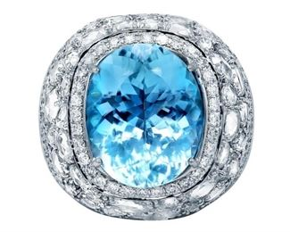 AN AQUAMARINE AND DIAMOND RING Stunning aquamarine, diamond, and 18KT white gold ring with a center oval-shaped 13.68 carat aquamarine in a diamond setting comprised of 6.00 carats of round and rose cut white diamonds.