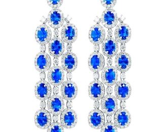 A PAIR OF SAPPHIRE AND DIAMOND EARRINGS Blue sapphire and diamond pendant earrings, incorporating 17.57 carats of sapphires and 7.00 carats of micropave diamonds set in 18K white gold.