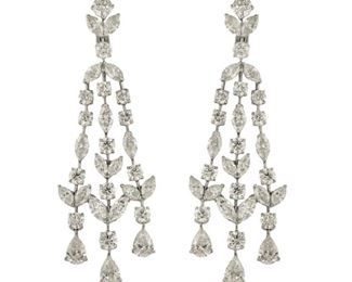 A PAIR OF DIAMOND EARRINGS, 30.5 CARATS Elegant diamond chandelier earrings displaying five GIA certified diamonds and a bevy of round, marquise, and pear shaped diamonds totaling 30.5 carats, all set in 18K white gold.