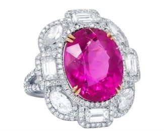 """A PINK TOURMALINE AND DIAMOND RING Special design pink tourmaline and white diamond ring, features a beautiful 11.80 carat tourmaline set with emerald cut and marquise cut diamonds in a """"petal"""" arrangement about the central stone, each diamond in turn surrounded by a halo of diamonds. A total of 3.80 carats of beautiful white diamonds."""