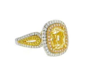 A YELLOW AND WHITE DIAMOND FASHION RING Fancy yellow diamond fashion ring, the central cushion cut diamond 5.02 carats and EGL certified FY-SI1, mounted in a double halo split diamond setting with 2.00 carats of white and pink diamonds, in a white and yellow gold setting. With EGL certificate.