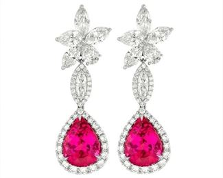A PAIR OF DIAMOND AND PINK TOURMALINE EARRINGS Pink tourmaline and diamond cluster drop earrings, presenting two large tourmalines, 12.70 total carats, suspended beneath diamond clusters incorporating 10.15 carats of marquise and round diamonds, all set in 18K gold