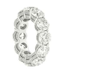 A DIAMOND ETERNITY BAND, 11.65 CARATS Timeless diamond and platinum Eternity band, presents 12 round diamonds totaling 10.85 carats further highlighted by the addition of .85 carats of round micropave diamonds on the sides of the settings.