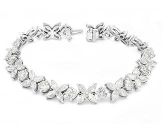 A DIAMOND AND GOLD BRACELET, 20.02 CARATS Impressive diamond and 18KT white gold bracelet, set with 13 round white diamonds and 52 marquise white diamonds, all totaling 20.02 carats.