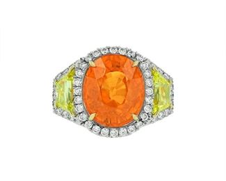 A MANDARIN GARNET AND DIAMOND RING A most creative Mandarin garnet and diamond ring. The 13.20 carat orange garnet is set among round diamonds, 1.50 carats total (F-G, VS), and 1.5 carats of yellow diamonds set on the sides, the entirety mounted in platinum and 18K yellow gold. C. Dunaigre Switzerland Laboratory certification. C. DUNAIGRE REPORT #CDC 1711568