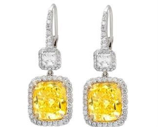 A PAIR OF WHITE AND YELLOW DIAMOND EARRINGS, 12.76 CARATS TW Distinguished pair of fancy yellow and white diamond earrings set in platinum and 18KT yellow gold. The earrings feature two radiant yellow diamonds, 10.76 carats total weight (FLY-FY, VS) suspended beneath 2.00 carats of Ascher cut diamonds, with all four stones totally encircled by micropave round diamonds. Natural untreated diamonds, the white diamonds near colorless white, slightly included. With GIA certificate.