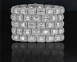 A DIAMOND TENNIS BRACELET, 90.55 CARATS TW A most impressive piece of jewelry, a platinum five-row tennis bracelet mounted with 85 emerald cut diamonds totaling 64.45 carats, even further enhanced with the addition of micropave round cut diamonds surrounding each larger diamond, adding an additional 26.10 carats of beautiful gems.