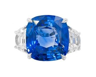 """A SAPPHIRE AND DIAMOND RING A platinum-mounted sapphire and diamond ring, features a 13.07 carat cushion cut sapphire GRS certified """"no heat"""", set between two half-moon diamonds, total weight 1.69 carats. With GRS sapphire certificate. Natural untreated diamonds, the white diamonds near colorless white, slightly included. GRS CERTIFICATE #GRS2015-061776"""