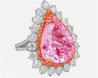 A KUNZITE AND DIAMOND RING Attractive kunzite and diamond ring, features a pear-shaped 21.55 carat kunzite with 4.75 carats of diamonds and .75 carats of pink tourmalines arranged in a halo with split shank , 18K white gold mount.