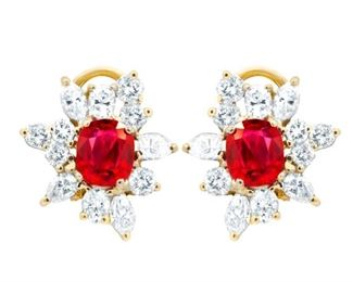 A PAIR OF DIAMOND AND SAPPHIRE EARRINGS Charming snowflake earrings crafted with 3.00 carats of round diamonds surrounding 2.65 total carats of rubies, all set into 18K yellow gold mounts.
