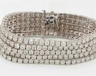 A FIVE-ROW DIAMOND TENNIS BRACELET, 36 CARATS A new twist on an original, a bracelet incorporating five rows of tennis bracelets meeting at their ends, with a total of 36.00 carats of round diamonds prong-set in 18K white gold.