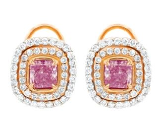 A PAIR OF PINK AND WHITE DIAMOND EARRINGS Light pink diamond earrings, features a fancy light pink .79 carat stone (RADC1008) and a 1.01 carat stone (RADC1009), both radiant cut and in halo settings which include a total of 1.50 carats of side pink and white diamonds in a micropave halo setting. With GIA certificates. Natural untreated diamonds, the other white diamonds near colorless white, slightly included. GIA CERTIFICATE #2135103917 : #1132250208 : #2135103917