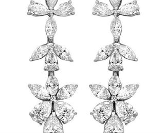 A PAIR OF DIAMOND EARRINGS An attractive pair of multi-stone diamond earrings incorporating pear and marquise-shaped diamonds weighing 5.015 carats, set into 18KT white gold mounts. Natural untreated diamonds, near colorless white, slightly included.