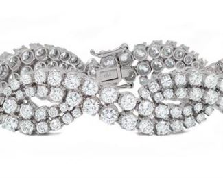 "DIAMOND INFINITY BRACELET, 18.06 CARATS Diamond Infinity bracelet, 168 round diamonds set in white gold, their total weight 18.06 carats. 7 1/4"" long. Diamonds are GH VS1/VS2, IGI certified #4205118881"