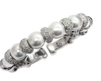 A WHITE PEARL AND DIAMOND CUFF BRACELET White South Sea pearl and diamond cuff, features four beautiful approx. 11.8mm pearls set with 3.17 carats of white diamonds. Natural untreated diamonds, near colorless white, slightly included.