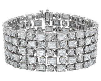 A FIVE-ROW DIAMOND BRACELET, 50 CARATS Fifty carats of white emerald cut diamonds and surrounding round cut diamonds, G/H/I in color, VVS/VS, mounted in 18K white gold and assembled into a spectacular five-row bracelet. Natural untreated diamonds, the white diamonds near colorless white, slightly included.