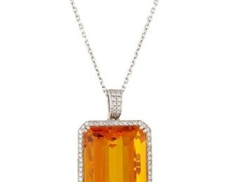 A CITRINE AND DIAMOND PENDANT Citrine and diamond pendant, features a 70 carat citrine surrounded by a total of 2.15 carats of white diamonds forming a halo, as well as appearing on the sides and bail. 18KT white gold mounts and chain.