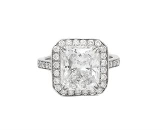 A 4.18 CARAT WHITE DIAMOND RING Gorgeous GIA certified 4.18 G, VS-2 cushion cut diamond in a halo setting of an additional 0.70 carats of white diamonds. With GIA certificate. Other white diamonds are natural untreated diamonds, near colorless white, slightly included. GIA CERTIFICATE #17446141